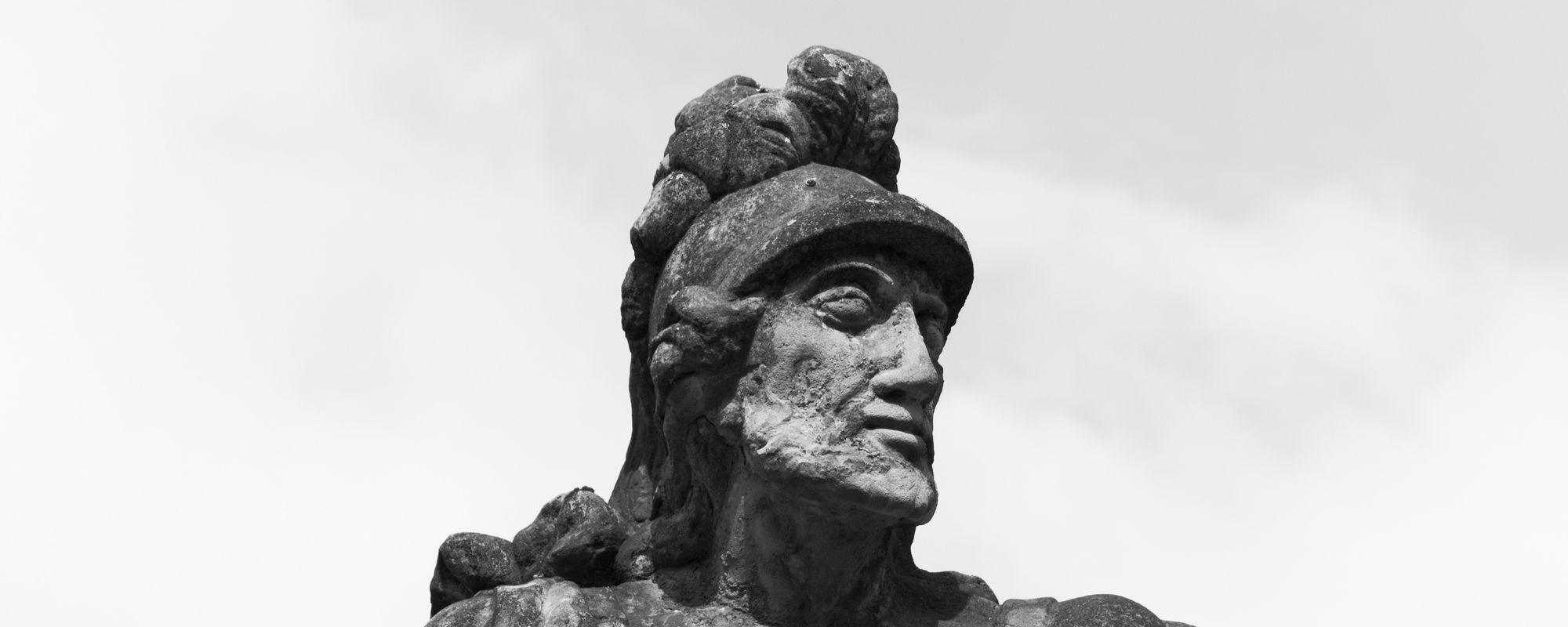 Head detail of an ancient statue of a man