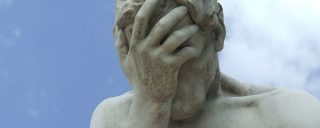 Statue depicting a facepalm