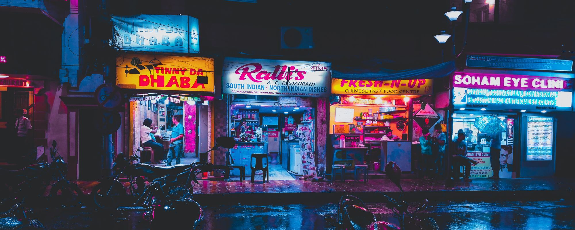 Row of Indian shops and restaurants, after rain
